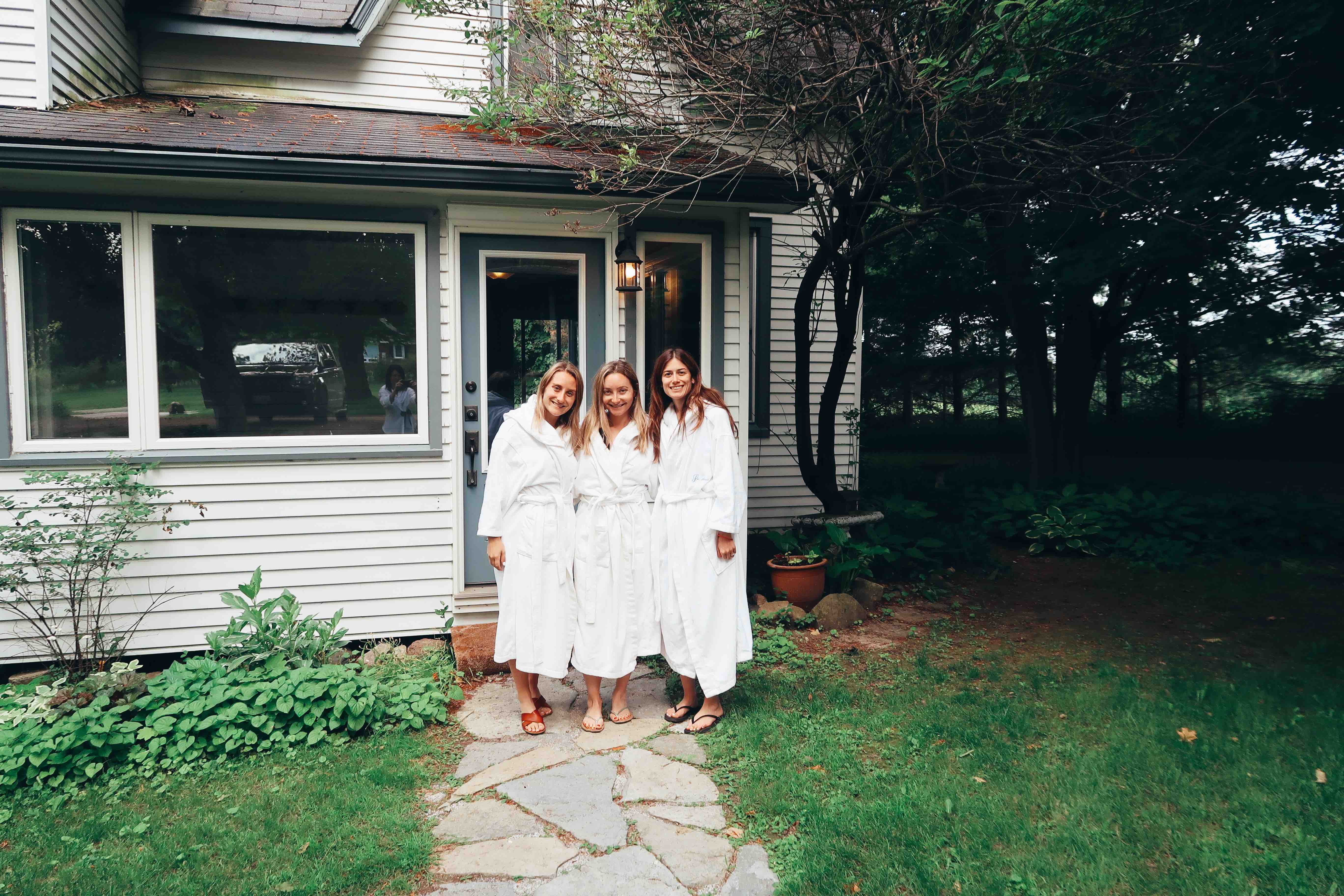 jordana hart toronto nutritionist and blogger and two friends at ste annes spa smiling in white robes
