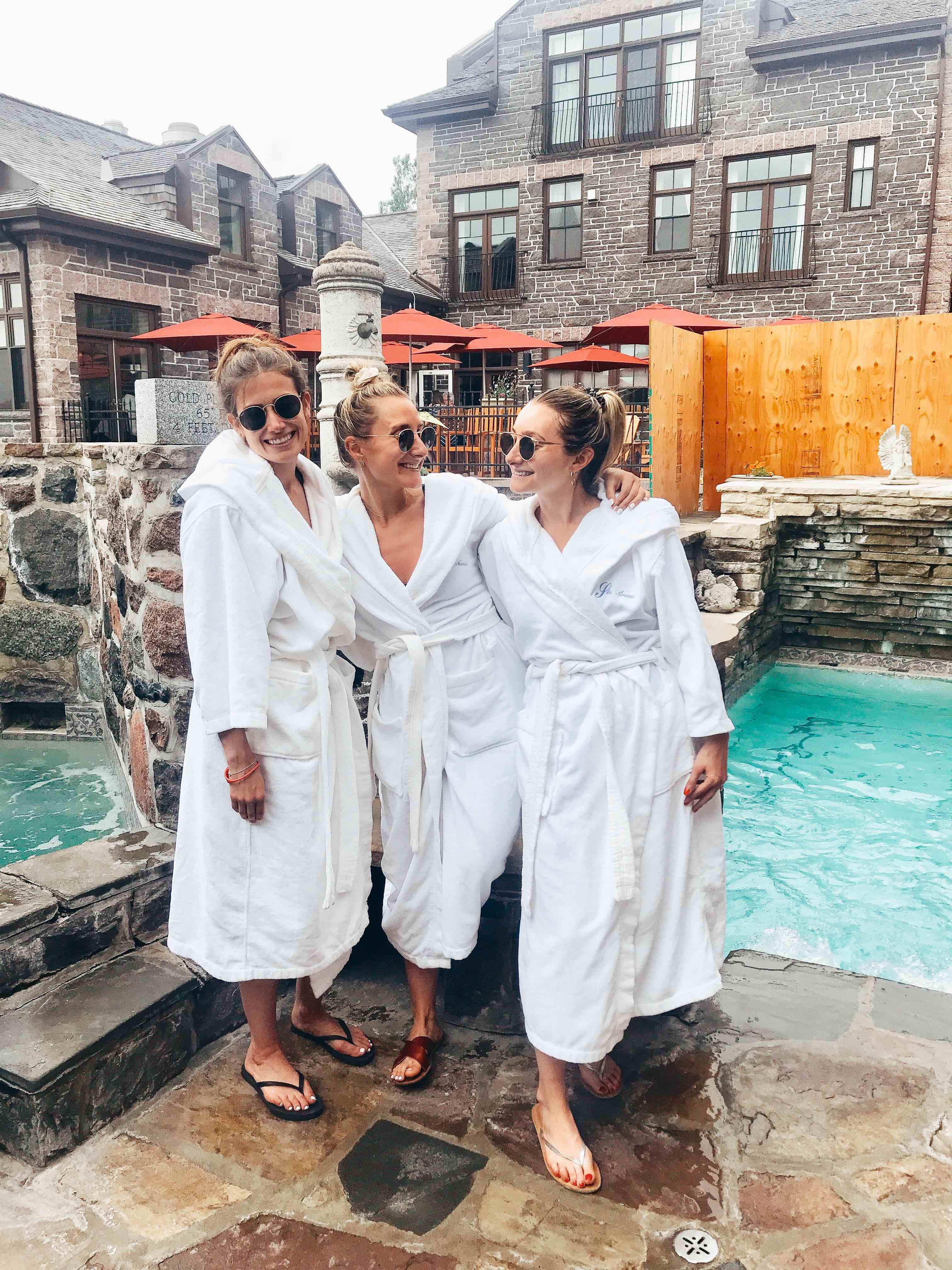 jordana hart toronto blogger and nutritionist with friends in white robes smiling at ste annes spa